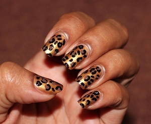 My first attempt at leopard nails. They are really simple to do. See my tutorial for my step by step guide: http://chinadolltt.blogspot.com/2012/07/golden-leopard-nails-with-tutorial.html