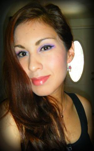 Purple lids, teal eyeshadow and bottom lash line and a nude lip (MAC Glam V)