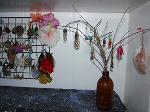 Been trying to find cute ways to display my jewelry and decorate my room so I decided to make a little earring tree :) It adds a nice bohemian flair to my bedroom.