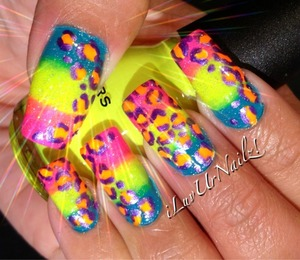 This is my Lisa Frank Inspired Mani I loved the stickers as a child and this reminds me of it so much. Absolutly love these colors together... I used are Sinful colors savage at the base of my nails in the middle Sinful Colors Neon Melon and at the tips i used China Glaze Pink Voltage then topped it of with China Glaze Fairy Dust. The Leopard spots are neon orange and purple  http://iluvurnailz.tumblr.com/