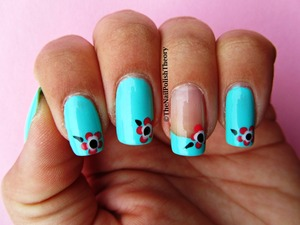 Mint as base colour and pink flowers made witha a dotting tool.