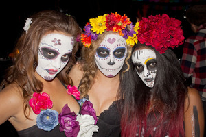 Three girls show off their Day Of The Dead makeup