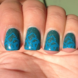 ChG Exotic Encounters and Fairy Dust with a BM 300 series stamp over the top in SH Brisk Blue http://polishmeplease.wordpress.com