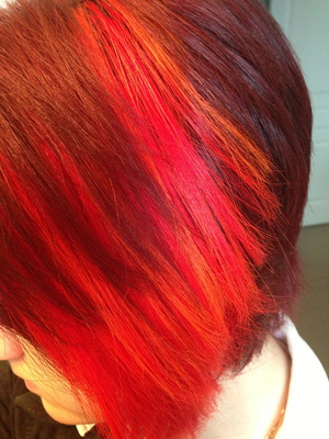 This bright neon patch was created by Kate Slemko of Salon Front in #Edmonton #yeg.  She used Special F/X High Octane, Napalm Orange and Cherry Bomb.  #haircolor #haircolour #hair #hairdye #hairstyle #style #neon #streaks #colorblocking