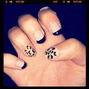 Nude nails with black French tips. Cheetah print for thumb and ring finger. :)