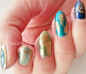 Gorgeous ombre/gradient from jewel-toned blue to antique gold, topped with some fun paisley stamps. http://www.beautybykrystal.com/2013/10/antique-gold-on-blue-to-gold-ombre-nails.html