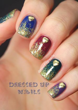http://www.dressedupnails.com/2013/04/glitter-gradients-and-heart-stud-nails.html