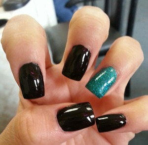 simple black nails with one sparkly teal nail