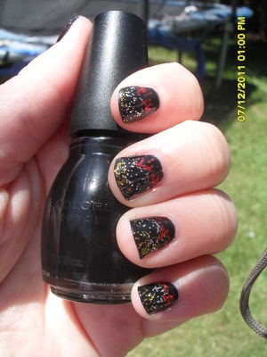 Sinful Colors- Black on Black- I played it up with some gold, silver, and red sparkles