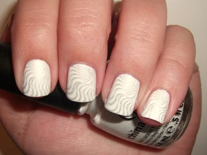 China Glaze White on White is my new favorite white polish. It's so nice and opaque in 2 coats! :)