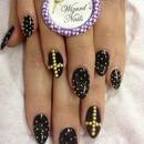 black and gold stilettos :)