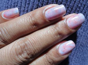 Speckled water coloured nails: http://chinadolltt.blogspot.com/2012/04/speckled-water-coloured-nails.html