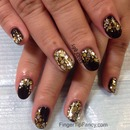 Black with gold and silver holograms and glitter.