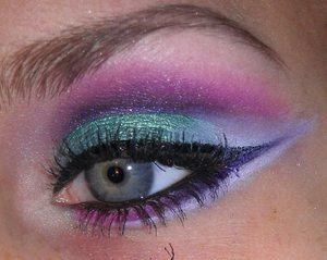 """Not sure what the black thing is at the bottom of the picture! It's in my camera lens!! :( For the green I used """"Edgy Emerald"""" from Maybelline's Color Tattoo Eyeshadow For the pink, I used Coastal Scents 88 Palette in the hot pink shade. For the purples, I used Maybelline's Color Explosion Eyeshadow Palette in """"Amethyst Ablazed"""" For the white, I used NYX Jumbo Eyeshadow Pencil in """"Milk."""""""