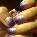 Silver holo with purple gradient.