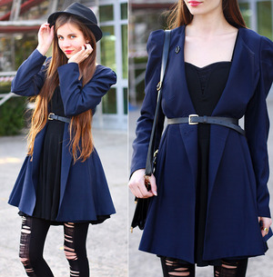 Blue trench coat,featuring a sweet style,a round neck with long sleeve,double breasted design to the front with wild pleating around the shoulder,skirt design hem with long length to the finish.