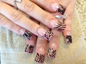acrylic lace an animal print nails stenciled.