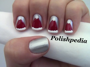 I love Santa's outfit and decided to focus some attention on his lovely hat!  Watch My Video Tutorial @ http://polishpedia.com/santa-claus-hat-nail-art.html