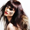 Red lip, Black liner. Funky stencil,  Funky teased hair