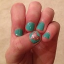 Teal nails with a pink heart