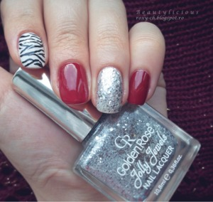 http://roxy-ch.blogspot.ro/2014/01/zebra-print-with-red-glitter-accents.html