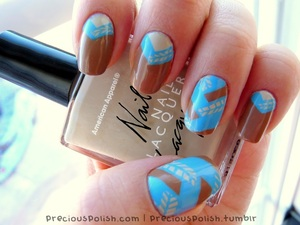 Check out my blog for a step-by-step tutorial for this design! http://www.preciouspolish.com/2012/04/tutorial-fishtail-nails.html