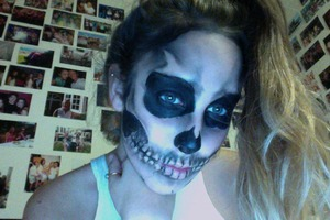 My face, I did this for halloween, inspired by Rick Genest (zombie boy) I did this look entirely out of black eyeshadow and liquid liner, in the mirror, on myself.