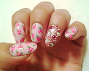 Floral pattern with a bedazzled ring finger. Colors used: Essie - Mademoiselle  Essie - Pretty Edgy OPI - Alpine Snow