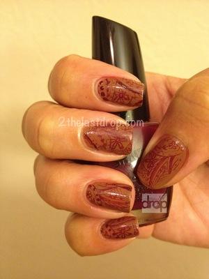 Henna. http://2thelastdrop.com/2012/05/19/henna-inspired-manicure/