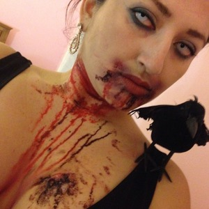 My last night #halloweenmakeup as either #blackcrow or a #freshvampire that recently being attacked! And all she wanted was blood blood blood.