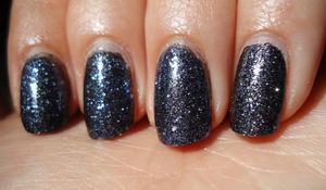 layered a dense blue glitter over a black one