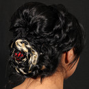 Textured, Floral inspired updo.