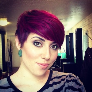 We applied straight Scruples Demi-Permanent color all over my head. Purple all over the sides, back and on the too at the roots! We applied the pink halfway up and all the way to the ends on the top!