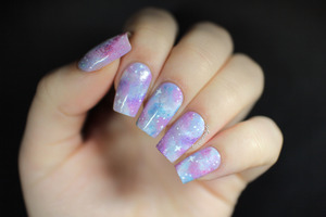 More info + a tutorial here: http://www.lacquerstyle.com/2013/11/holographic-pastel-galaxy-nails.html