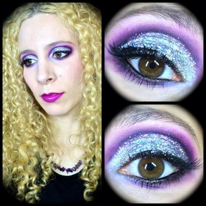 http://michtymaxx.blogspot.com.au/2014/01/new-years-eve-makeup-2014.html  Here's my New Years Eve makeup for 2014 and I went all out big time with silver holographic glitter and a dramatic cut crease. I took the photos at the end of the night after falling asleep in my makeup unfortunately but it actually still looks pretty good.