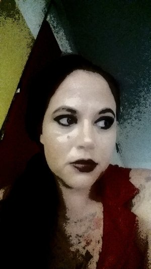 love the way this photo turned out all makeup except eyebrows is kvd, my favorite lipstick at the moment vampira(: