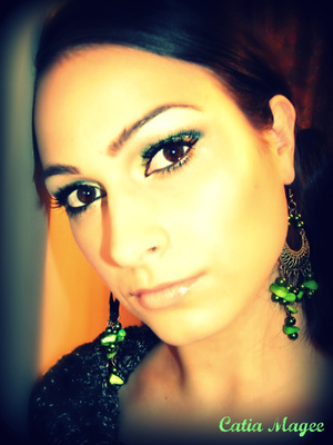 Jewelry: by Foxxy Fashions www.foxxyfashions.com Using Pure Fusion Mineral Eyeshadows in  Emerald all over the lid  Dragon Scale on the tear duct and inner corner  French Cafe on the crease as transition color  and White velvet on the brow highlight