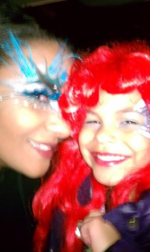 halloween 2011... i was an evil angel and thats my daughter.. princess ariel... i did both of our makeup