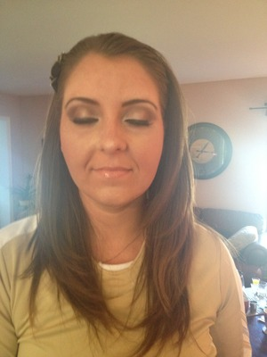 Client requested luminous gold and brown eyeshadow, fake lashes, very natural airbrush, peachy-bronze blush, and glossy nude lip