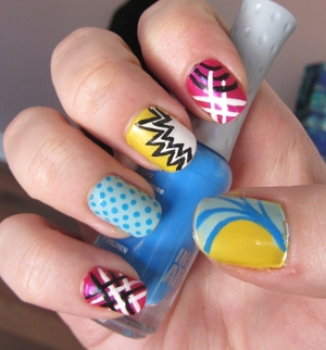 Check out the NOTD at http://rivuletsbeauty.blogspot.ca/2012/03/notd-kapow-graphic-inspired-nails.html (: