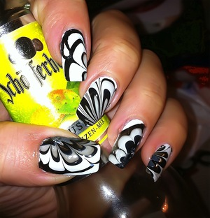 Water marbling using black and white nailpolish