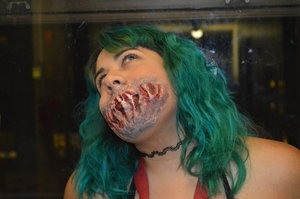 Speak No Evil Mouth Help from YouTube Tutorial: Glam&Gore Materials: Liquid latex, blood, cotton balls, and eye shadow