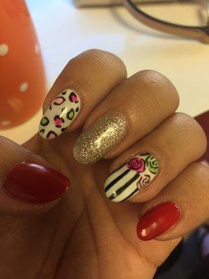 Cheetah print nail art with glitter, red, silver, stripes, pink, green, roses, natural nails, gel mani