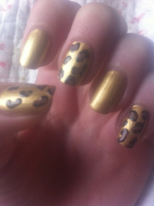 using gold brown and black nail polish. the leopard sports were done with a dotting tool.
