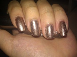Sally Hansen Time to Shine. Sheer-ish coverage and brush strokes can be seen sometimes but I like it all the same. It's a really nice brown-ish version of Luxe. It's really sparkly which I like.