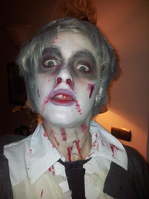 Used fake blood,  red Rimmel lipstick, eyeliner pencil, black eyeshadow. White fancy dress makeup.