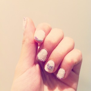 Reverse french manicure using caviar beads with nail polish...