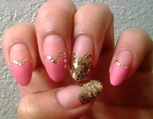 Soft, matte pink, with gold accent glitter.
