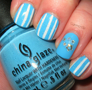 China Glaze Bahamian Escape, white acrylic paint, inm Northern Lights topcoat and silver holographic star glitter