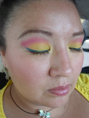 yellow , hot pink and turquoise eyeliner...  i was feeling colorful  this particular day  and i loved it..   primer potion - eden ulta eyeshadow - honey bee NYX trio eyeshadow - cherry/hot pink Urban Decay liquid eyeliner - siren urban decay curling mascara
